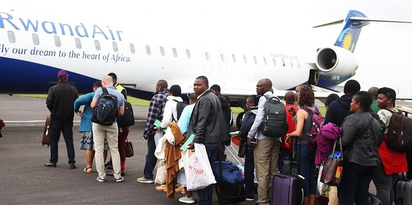 Passengers queue to board a RwandAir plane during the launch of Kigali-Cape Town route recently. Experts have called on African countries to emulate Rwanda by embracing a visa-free policy. / Sam Ngendahimana